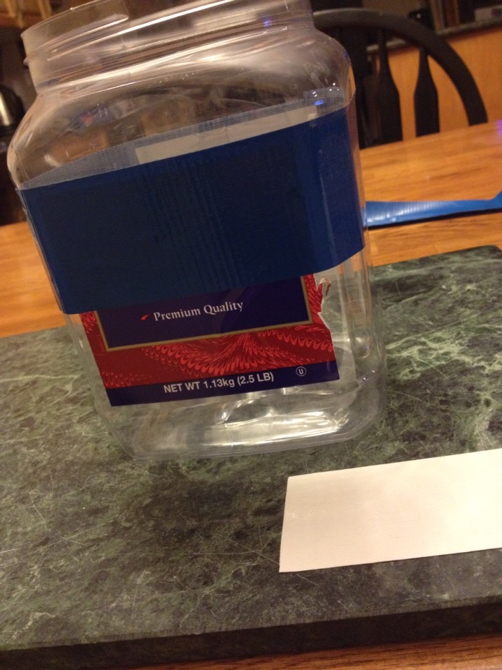 2. Measure how much duct tape is needed to go around the jar once (blue duct tape) and wrap it near the top