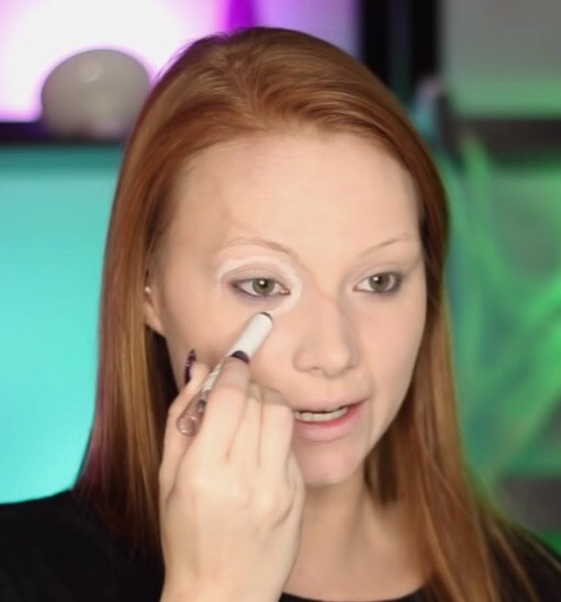 Leaving the eye area open, with a white eye pencil, follow around your eye socket .