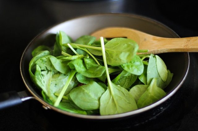 Step 4. Add the baby spinach and chopped basil leaves to the skillet. It's OK if the skillet seems very full -- the leaves will wilt and cook down. Stir occasionally until the leaves have completely wilted, about 3 minutes.