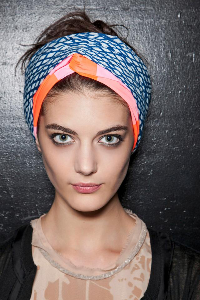 A traditional turban look goes perfectly with a tousled, messy bun or ponytail.