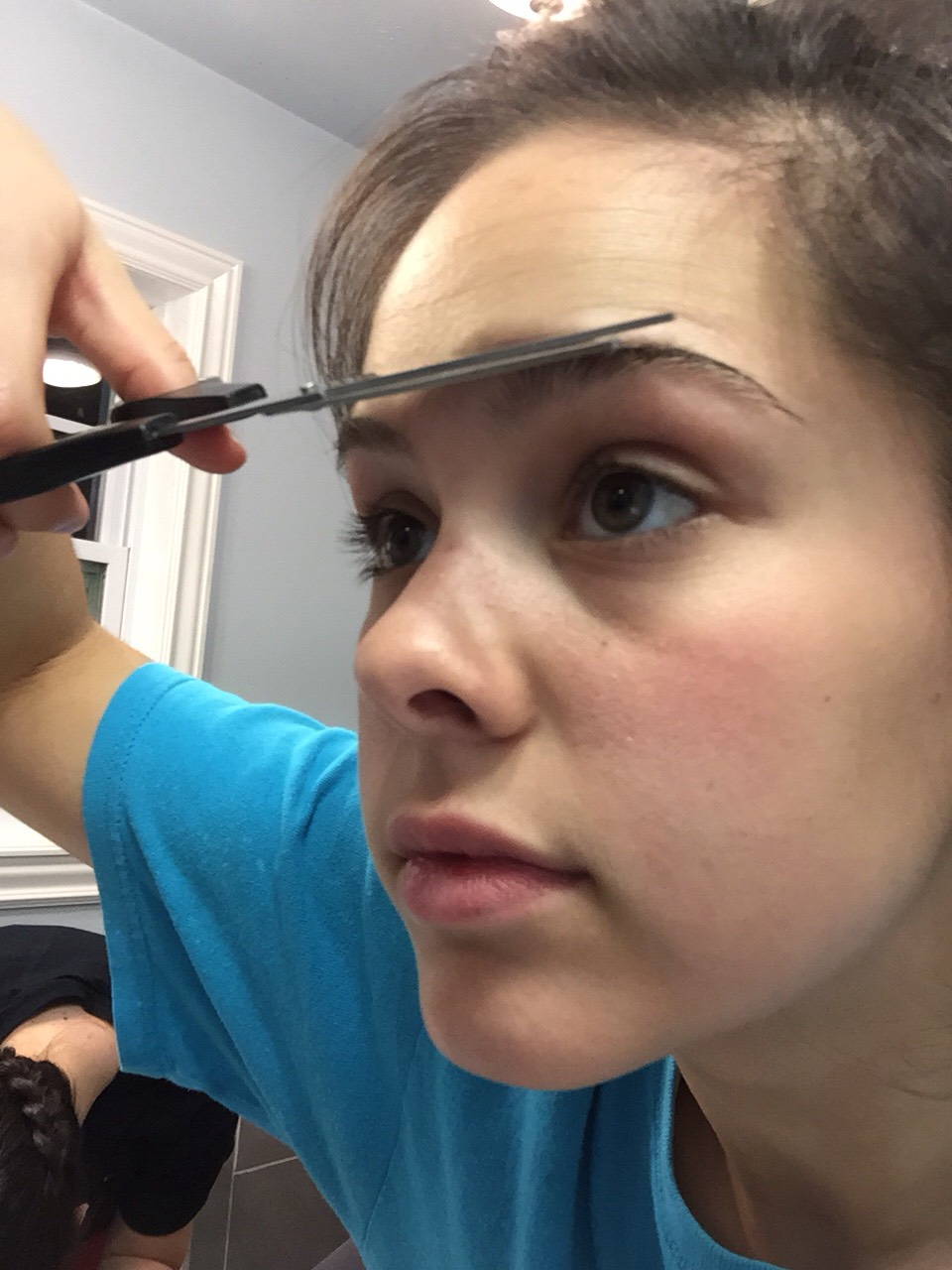 """Step 2: Start by brushing your brows upward and clipping the stray strands or simply cutting down your eyebrows to the shape you want. If you are nervous at first, just start with a simple """"clean up"""" job. Only focus on getting rid of stray hairs and not truly shaping your brows yet."""