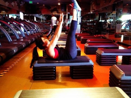 Lay on the floor or a bench with your legs straight out, arms stretched above your head, toes pointed towards the ceiling. Raise your arms towards your toes as you raise your legs to a 45- to 90-degree angle, keeping your shoulders off the floor (above).