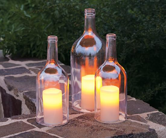 Cut the bottom off some bottles and place them over a lit motive candle.  To cut the bottom off just wrap a cotton string around where you want the cut to be, douse the string in Nail polish remover Light it and rotate the bottle a few times, dunk in ice cold water and the bottom will pop off!