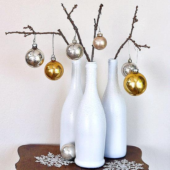 Holiday Decor Help bottles morph from recycling to holiday decor with our Winter DIY instructions. What You'll Need:  Wine bottle White spray paint Spray paint Spray adhesive Epsom salts  spray-paint in even strokes until the bottle is coated. Let dry and then touch up as needed.