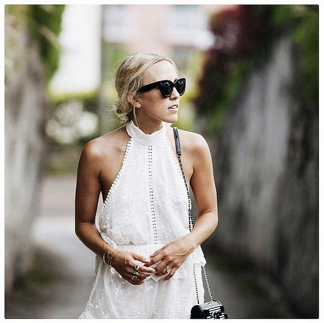 And Make a Daring Cut Look Romantic and Effortless With the intricate details on a breezy romper like this one, you can go braless without being obvious about it.