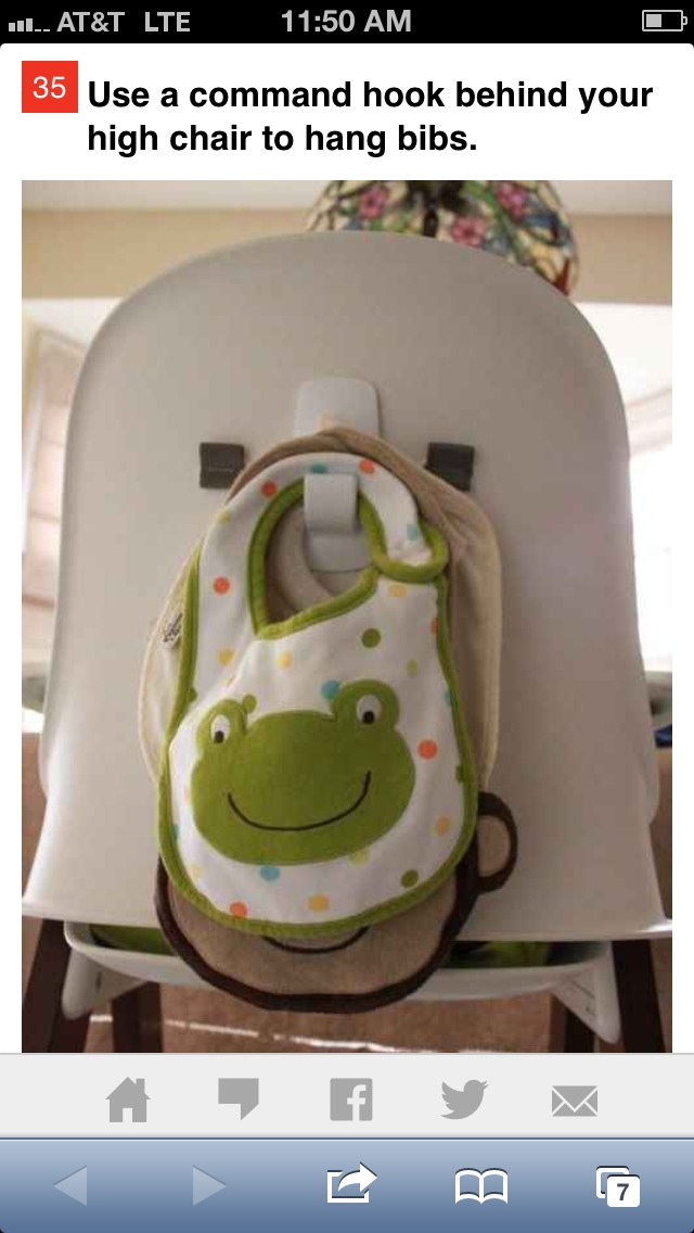 Use a command hook to stick to the back of your child's high hair to hold a few bibs. To hold more- attach the bibs to an old hair tie or ribbon and then hang on the hook.