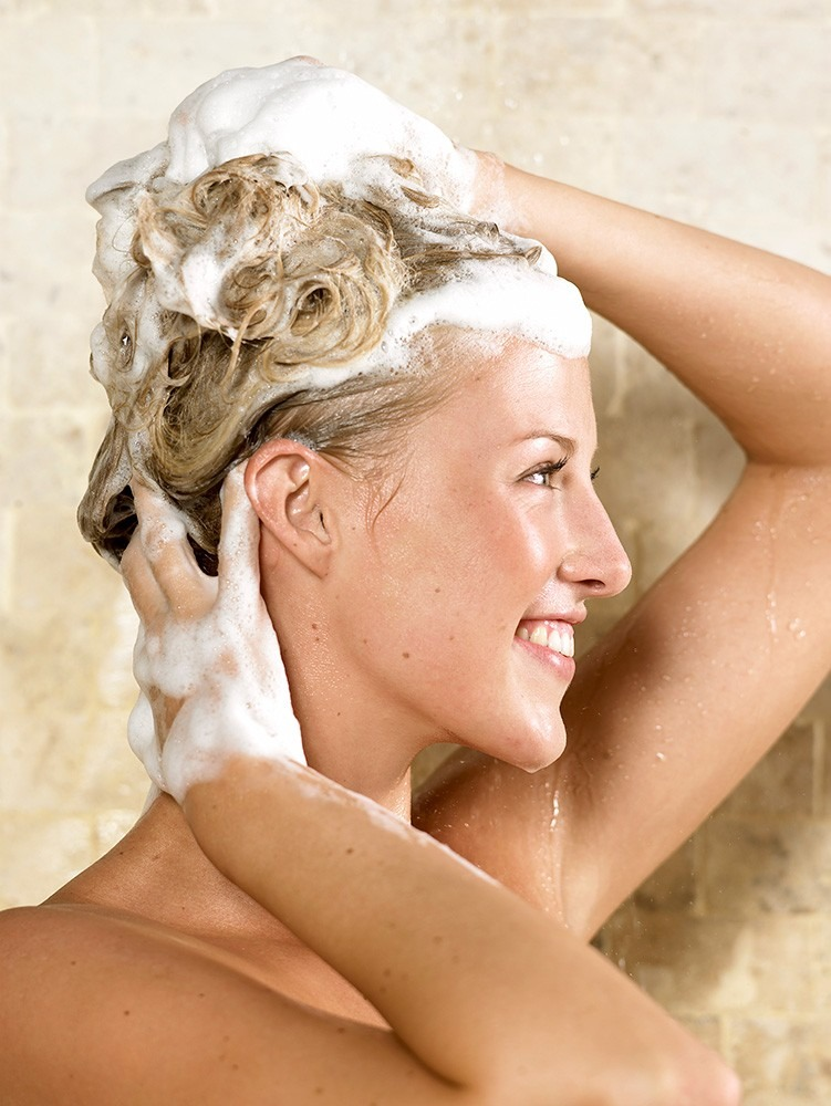 Wash your hair twice with shampoo to make sure the olive oil gets washed out properly