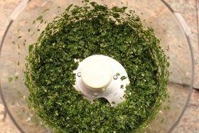 Step 3. Add the basil leaves. Give them a whirl until they are finely chopped.