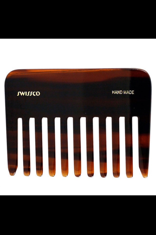 For Detangling . . . A detangling brush like Swissco's Tortoise Wide Tooth Comb ($9) is great for getting knots out on the go. But you should only ever use a plastic comb like this on dry hair, since the teeth are hard and can cause breakage on wet strands.