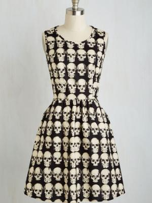 Down To The Flare Bones Dress Now, if you really want to splurge on a dress that your little morbid self will legit wear all year round, this skull dress is an amazing option. The flare at the waist is just perfect! Buy it at Mod Cloth for $89.99