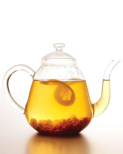Drink two, 8 oz. glasses with half a lemon in each glass after taking the pills. Tea can be hot or cold.