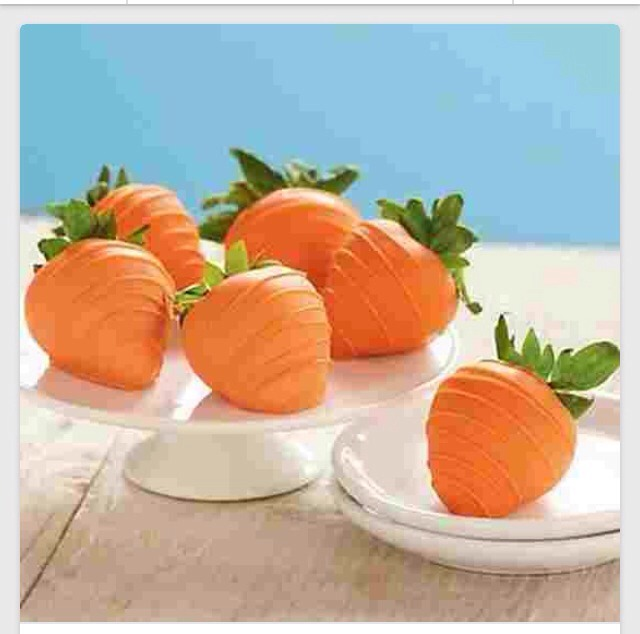 Just dip in orange candy melts! Use a double boiler to melt and make sure strawberries are dry, but just dip and set on parchment paper so they won't stick ! Sooo cute