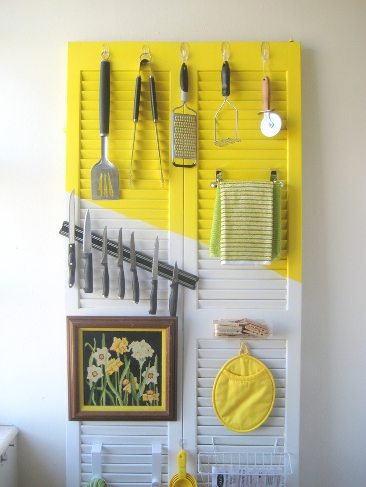 2. Repurpose a cabinet door to organize your kitchen.