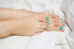 1) Apply a base coat. Let it dry for half an hour to be safe (you will see why shortly). You could watch your favorite television show to help pass some time. If it is not completely dry, your pedicure could not turn out right. How bad would that be?