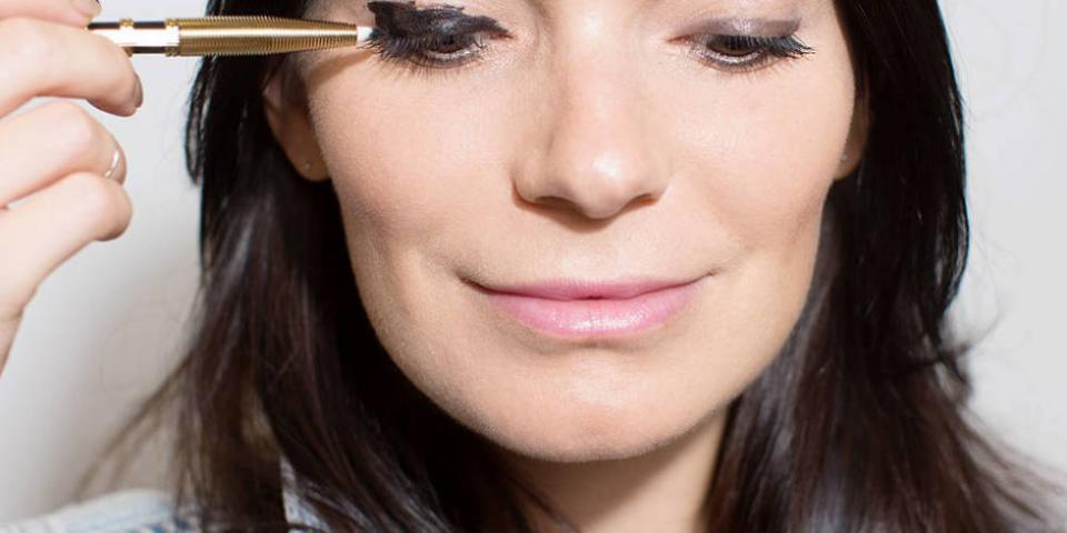 11. Create any shape of black eyeliner with a black cream liner formula, a cotton swab, and some balm.