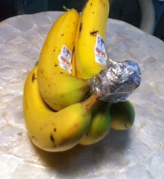 Cover the crown of a banana bunch with plastic wrap. They'll keep for 3-5 days longer than usual, which is especially helpful if you eat organic bananas. Bananas also produce more ethelyne gas than any other fruit, so keep them isolated on the counter.