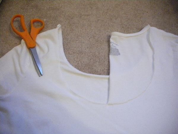 "3. Fold the half ""U"" over to the other side of the shirt to use it as a guide. Cut along so both sides are even."