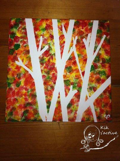 Take a canvas or board and using painters tape create a tree. Paint the leaves on the canvas. When you remove the tape, you are left with a tree.