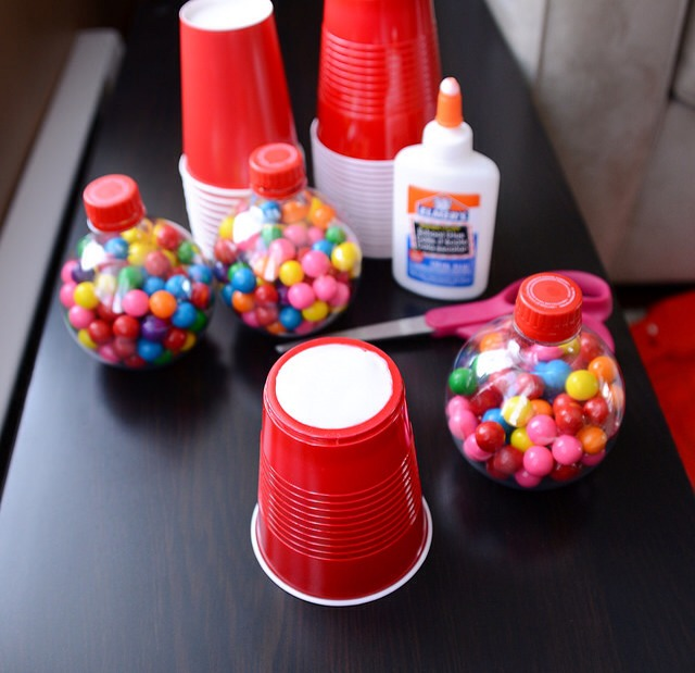 Turn your red solo cup upside down and cover the bottom with glue. Stick your Coca-Cola bottle on top and allow to dry!