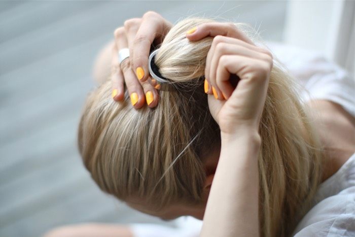 when you go to sleep, tie your hair up loosely.  having a tight hairstyle at all can damage your hair, making it come out