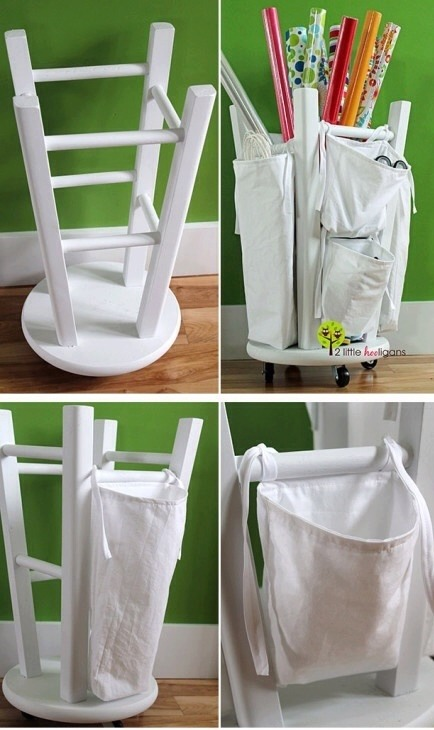 Attach wheels to an ordinary stool and turn it upside down. Repurpose old bags and tie them to the rungs on the stool- these will hold gift bags, ribbons, etc. Rolls of gift wrap fit nicely in the center of the stool. Wonderful to have!