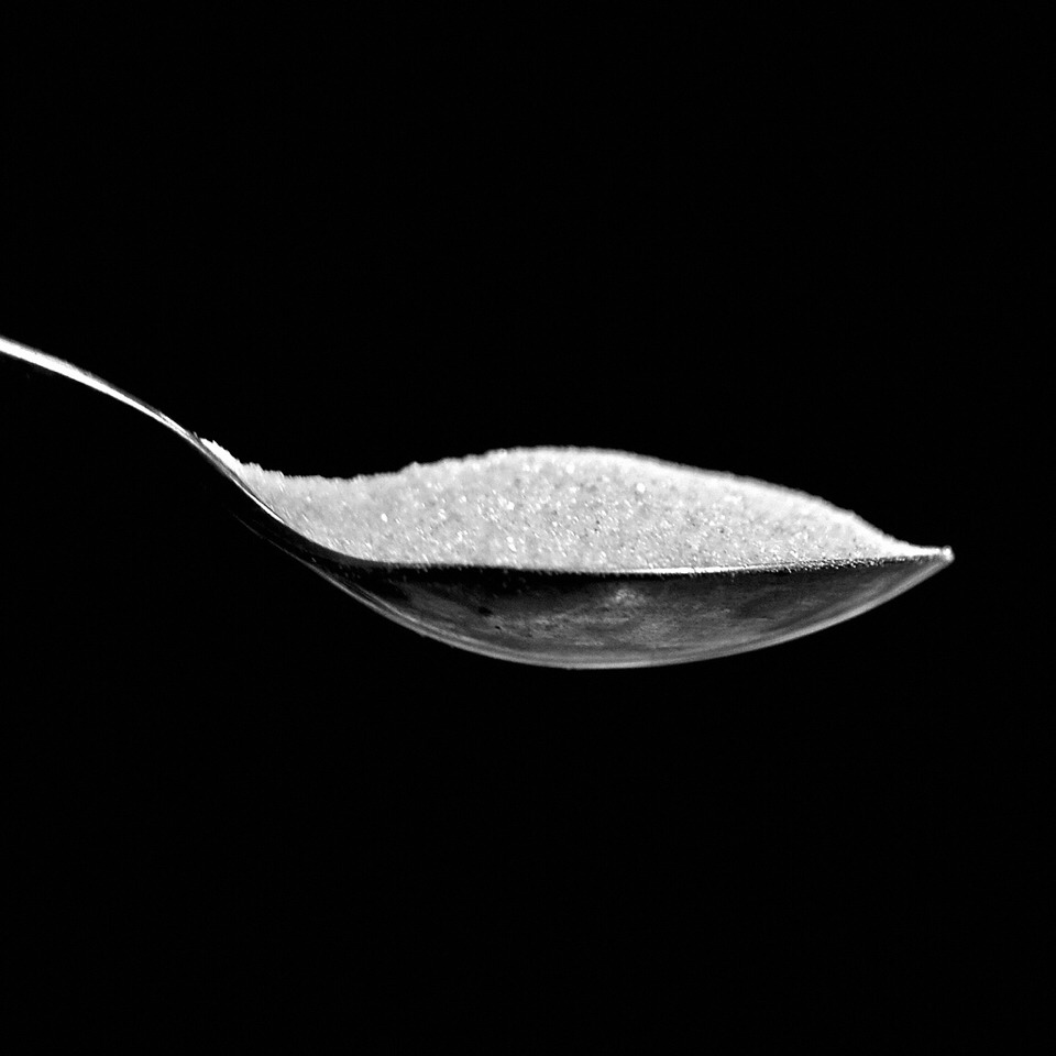 Take a spoon full of sugar and apply it to your burnt tongue!