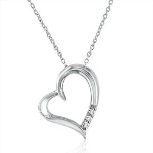 But her some nice jewellery, make it cute, focus around the hearts and it will remind her of you every time she wears it :)