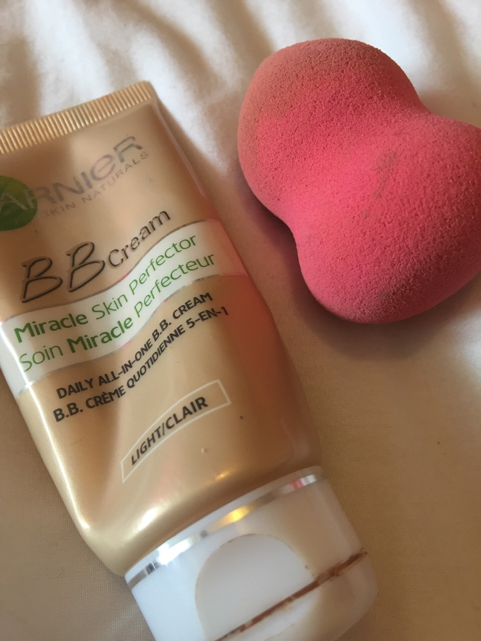 I use the Garnier BB cream, then I blend it out with my pink beauty blender.