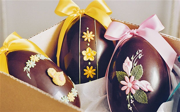 6. To decorate the eggs, sit an egg in a glass or small cup and use as a stand while you pipe. You can wrap your eggs in cellophane wrap and label them to give away or place them in a basket and offer them to guests.