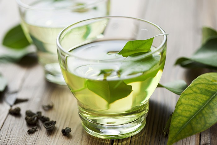 Place peeled ginger slice into the bottom of a mug along with a tea bag. Pour hot (boiled) water over and allow to steep for about 3 minutes. Add mint now if desired.