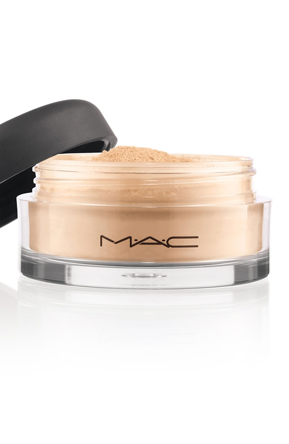 3. Dip a large, soft blusher brush into loose powder and tap off the excess powder, then dab onto greasy areas of the scalp. The powder will soak up the excess oil.