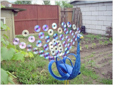 1. Make a Peacock with Old CDs and Tire