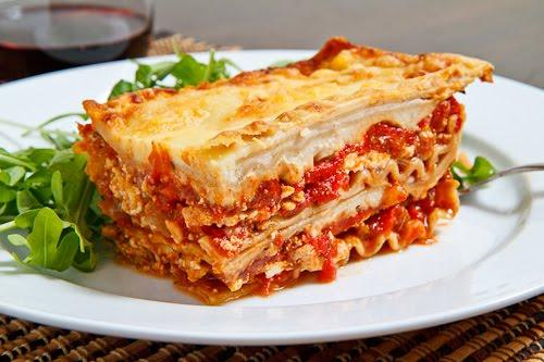 To assemble, spread 1 1/2 cups of meat sauce in the bottom of a 9x13 inch baking dish. Arrange 6 noodles lengthwise over meat sauce. Spread with one half of the ricotta cheese mixture. Top with a third of mozzarella cheese slices.