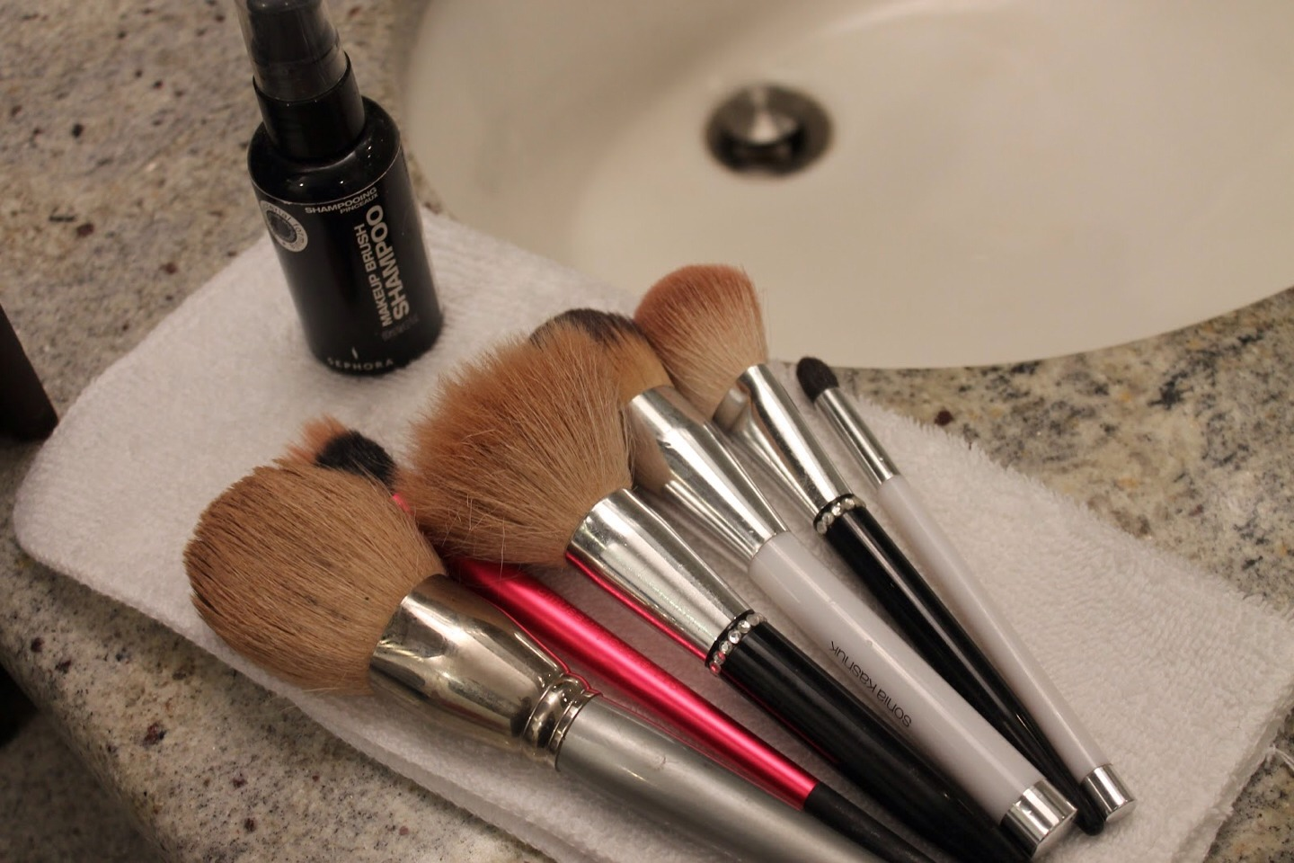 5. Lastly lay your brushes flat on the cloth to dry.