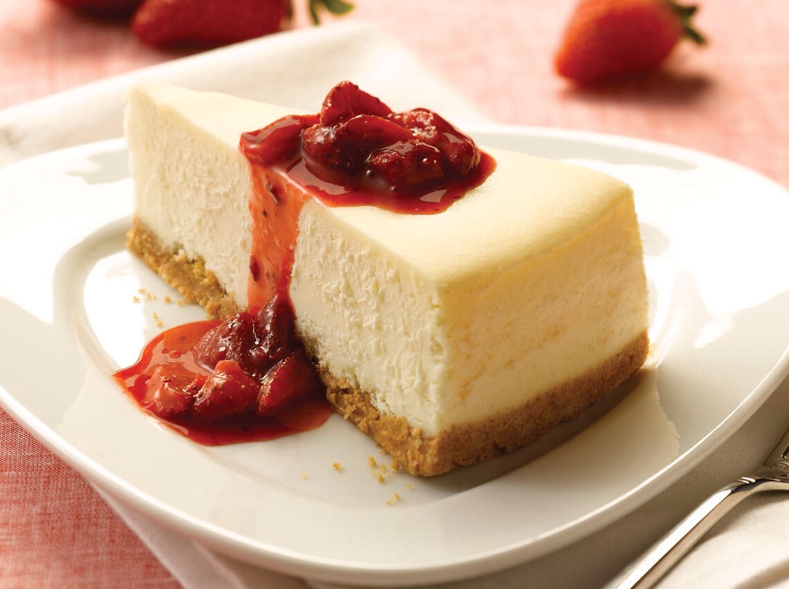 In a large bowl, mix cream cheese with sugar until smooth. Blend in milk, and then mix in the eggs one at a time, mixing just enough to incorporate. Mix in sour cream, vanilla and flour until smooth. Pour filling into prepared crust