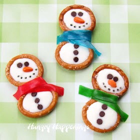 You may even opt to just create snowmen heads using the pretzel rings and candy coating. These are so quick and easy and look great in a candy jar.