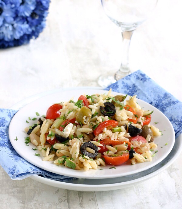 Orzo Salad with Cannellini Beans and OlivesThis salad has a distinctly Mediterranean feel to it — between the orzo, the feta, and the two different kinds of olives, you'll feel like you've jetset to a faraway island without ever leaving your dinner table.