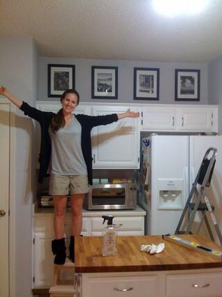 --> I always think of putting stuff on top but never hanging art, love this! --> Fill the annoying 'above cabinet' space in your kitchen w/black and whites of fave memories/defining moments - easy and good looking.