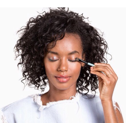 Step 2  A brown iridescent shadow is more compelling than a matte neutral, but it's subtle enough to let the bright eyeliner retain star billing. Dorman recommends applying it with a firm, slightly oval brush. In certain lighting, a glimmer of blue dances across the lids—gorgeous.