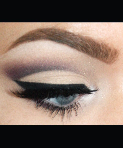 Ravndahl's false lashes (NYX Lashes in EL107 and NYX Half Lashes) finish off the cut crease eye makeup look.