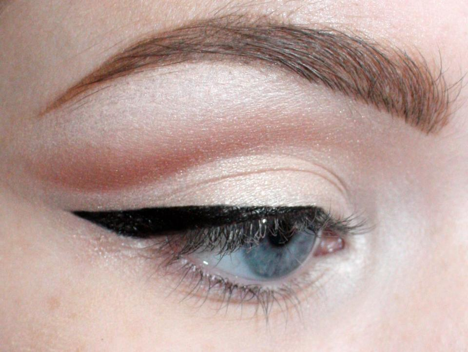 Take your favorite liquid/gel liner, and line only the outer half, winging out at the end. This will elongate and open the eye. You can keep yours thinner than this.
