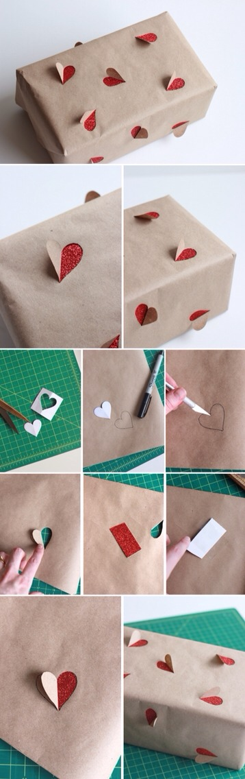 Step 3: With your x-acto knife, cut around one side of the heart from the top to the tip of the bottom. Step 4: Fold the heart over. Step 5: Because the glitter paper was so thick I cheated and cut out a strip of paper to line along the backside of the kraft paper gift wrap.