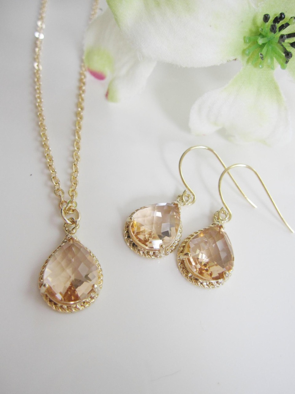 These earrings and necklaces would look great with the dress also it plane so it isn't clashing to much with the neckline and it's the perfect length too