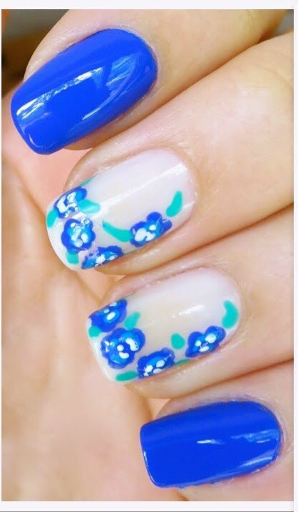 Blue and white square tips with cute little flower designs
