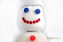 Use a permanent marker to draw a mouth of the snowman or cut out a piece of felt to glue on as a mouth