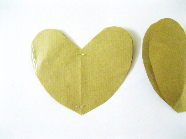 To make a pair of hearts, take 2 hearts and with right sides together staple them. Repeat the same with other 2 hearts.