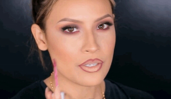 10. Fill in lips with a matte lipstick.  Glossy lipstick can highlight the over-lined lip line, which you don't want. In this gif, Desi uses Dose of Colors matte lipstick in Berry Me ($18). For a range of matte shades, try Lime Crime Velvetines ($20 each).