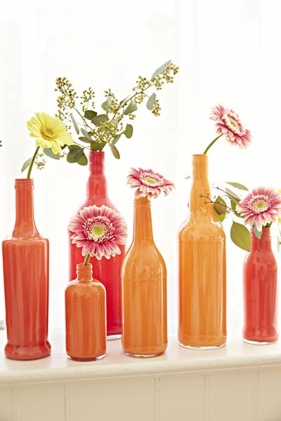 5. Bottle Vases Flowers will put a smile on your face! Give them a vibrant home by dripping paint into bottles and swirling it around the entire inside.