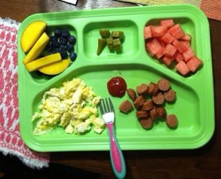 "Invest in a Lunch Tray  Unlike ""regular kid"" plates, a lunch tray's handy portion dividers ensure a food blob can't happen — unless the child wants a scrambled egg, ketchup, and hot dog gruel."