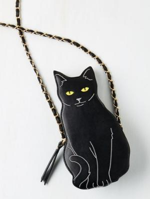 Cat To The Chase Bag Black cats have a bad rep, but all of us with sense know that they're just as adorable as any other cat. Show your black cat appreciation with this cute bag. It's big enough for the essentials, like your phone, money, and a little bit of makeup. Buy it at Mod Cloth for $39.99